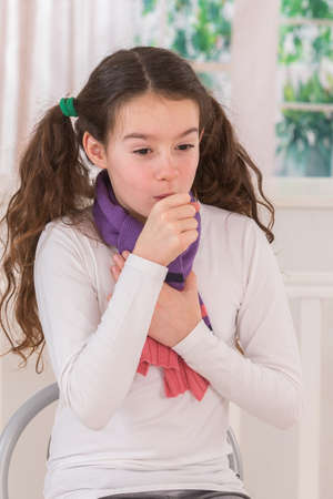 sniffle: Teen  girl coughs as she tries to recover from flu Stock Photo