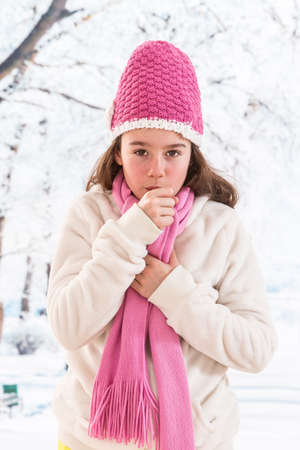 pharyngitis: Close-up of coughing girl on winter background
