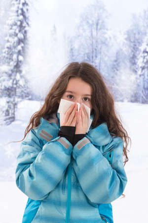 cold virus: the flu illness, a young girl sneezes disease