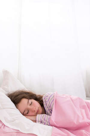 drowse: Young Teenager Asleep in Bed