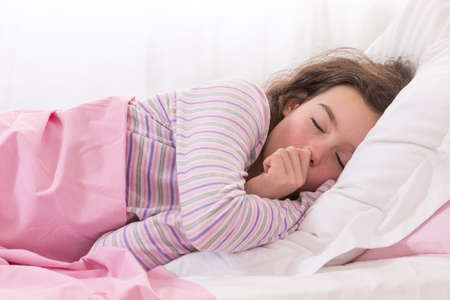 sleeping face: Young Teenager Asleep in Bed