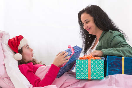 hospitalized: teenager   receiving her gift while she is hospitalized Stock Photo