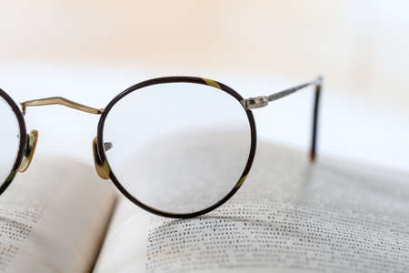 old vintage: Old books with eye glasses  vintage style