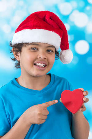 boy beautiful: little boy in Santa hat isolated with heart
