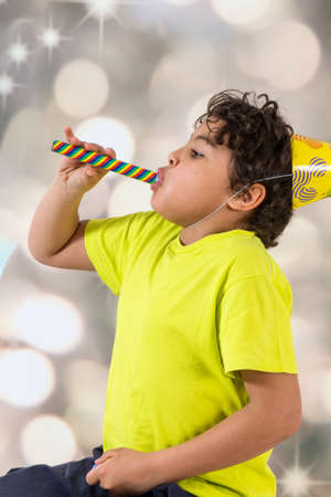 7 years old: Amusing little boy enjoying his party Stock Photo