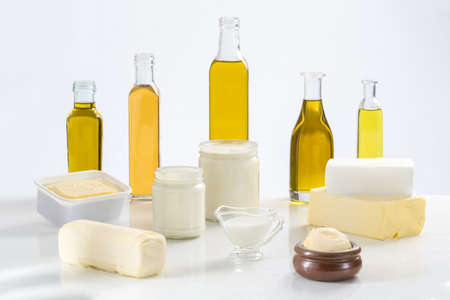 Bacground: culinary variety of fats on white bacground Stock Photo