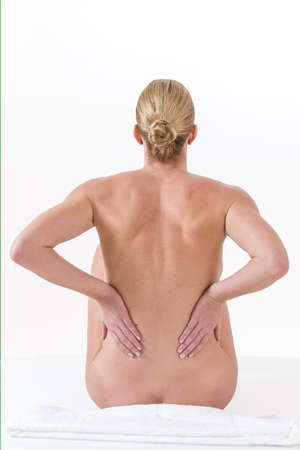 holding back: woman hand holding back pain or injury