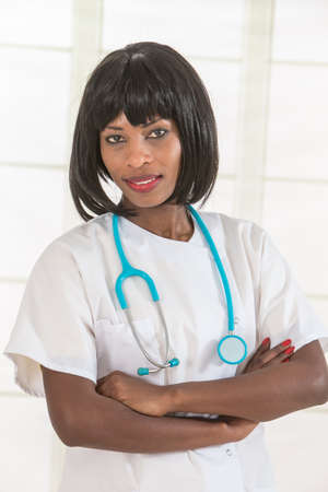 african american woman smiling: Female African American doctor or nurse smiling