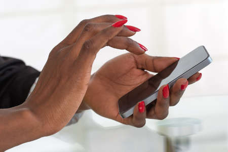 Business woman working with a mobile phone a