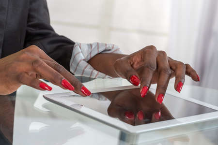 pointing device: black female hands using digital tablet