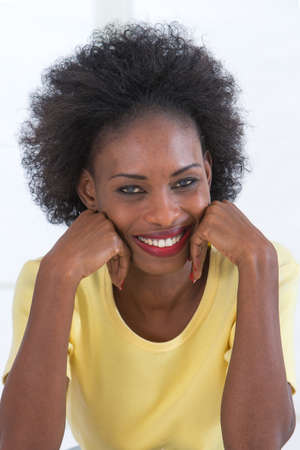 people laughing: portrait of an attractive african american woman smiling Stock Photo
