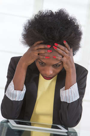 Portrait of mature black woman stressed at work