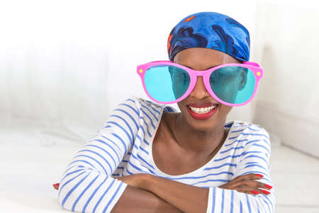 funny glasses: African woman wearing funny oversized glasses