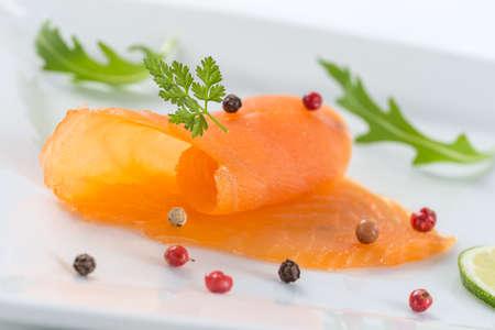 salmon ahumado: diner plate with salmon and salad