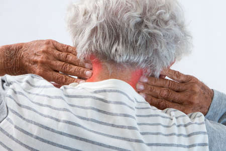 senior man on a neck pain: old man massaging his painful neck