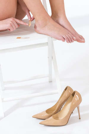high  heeled: female having pain after wearing high heeled shoes