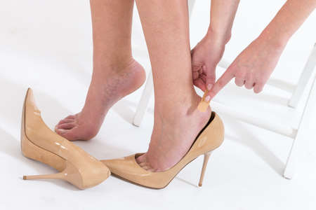 heels: female having pain after wearing high heeled shoes