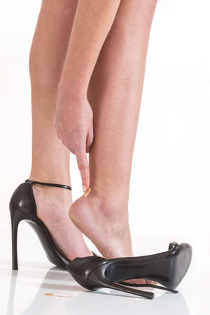 high heeled shoes: female having pain after wearing high heeled shoes
