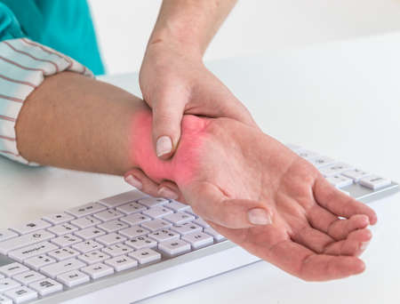 carpal tunnel: woman with pain on the wrist