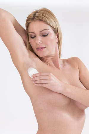 beautiful armpit: Young woman have appied stick of deodorant