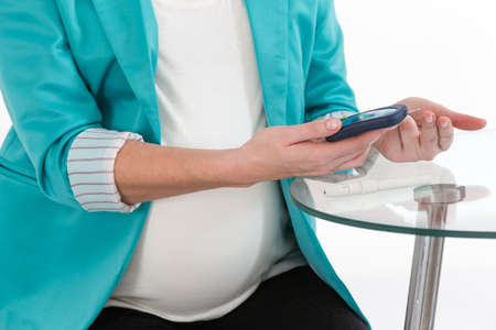 Pregnant woman making test that shows whether or not she has pregnancy diabetes