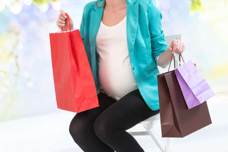 after shopping: Smiling pregnant woman sitting after shopping