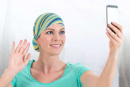 A woman, surviving from a cancer is picturing herself Stock Photo
