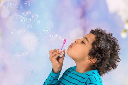 ittle: ittle boy blowing soap bubbles Stock Photo
