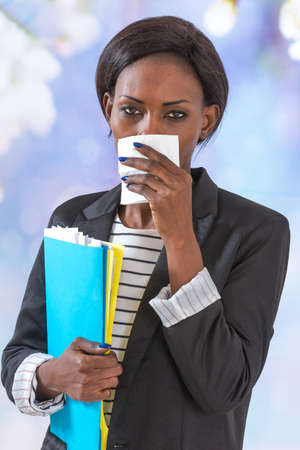 african business: african business  woman blowing her nose