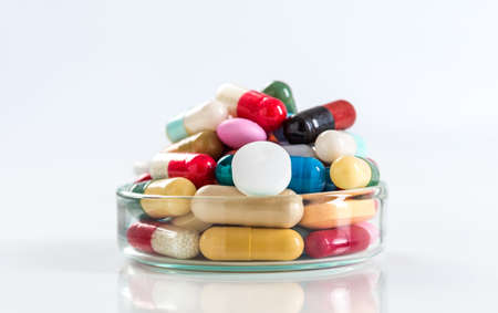 dispense: Various pills and capsules in glass containers