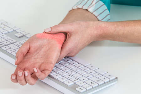 carpal tunnel syndrome: Professional desease from people  working with  computer Stock Photo