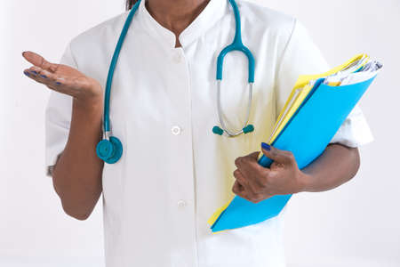 pathologist: healthcare and medical smiling african female doctor in hospital