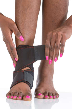 bunion: black woman  arranging  foot bunion and  plantar protection