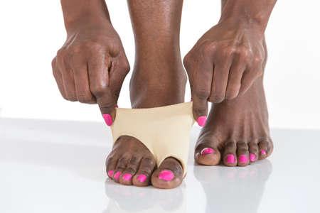 plantar: black woman  arranging  foot bunion and  plantar protection
