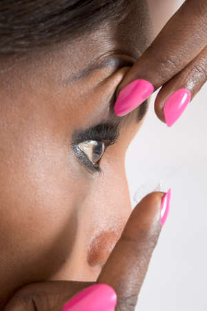 farsighted: view  of a woman   adjustment of contact lenses Stock Photo