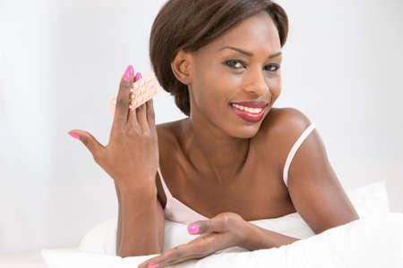 contraception: Eduction on contracepive pill African woman presentin oral contraception