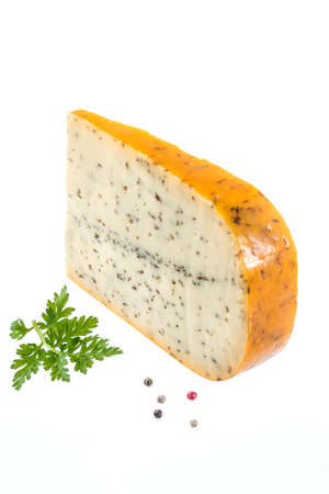portion: Portion of gouda with cuminon white background