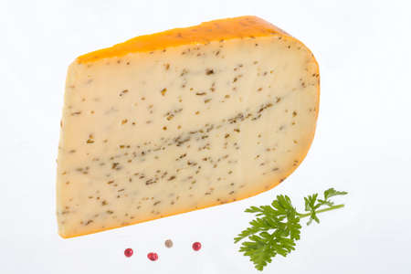 a portion: Portion of gouda with cuminon white background