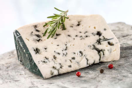 roquefort: Slice of Roquefort traditional french  cheese on white background Stock Photo