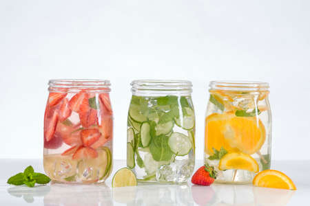 cucumbers: Tree jar of Healthy detox water with fruits.. Stock Photo