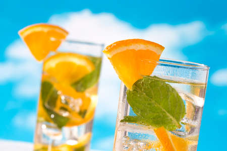 Summer drinks water with ice, mint and orange