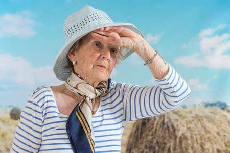 beautiful smiling senior woman enjoying life in countryside
