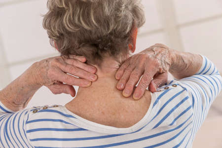 woman muscle: Back view of senior woman with neck pain Stock Photo