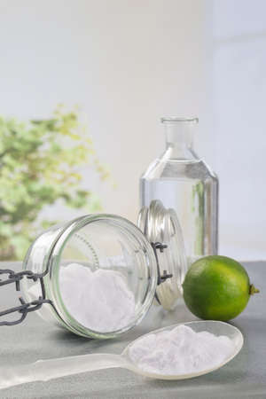 Natural cleaning tools lemon and sodium bicarbonate for house keeping Foto de archivo