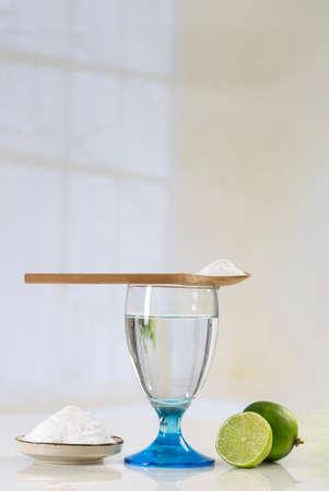 bicarbonate: A glass of water, lemon, soda bicarbonate