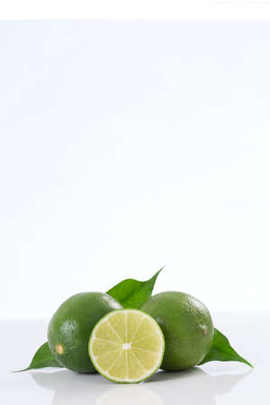 yellow lemons fruit and leaves sliced isolated on black