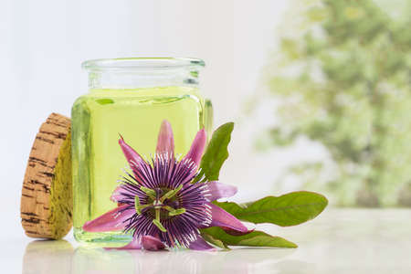 passiflora: Passion flower essential oil blue glass bottle, isolated over white background. Passiflora.