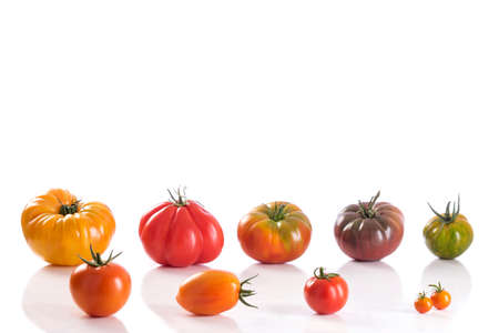 heirloom: Variety of Heirloom tomatoes on white background Stock Photo