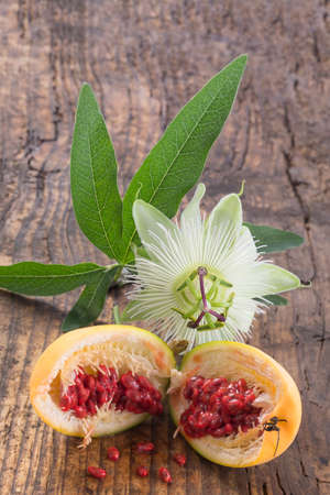 Flower and fruit Passionflower cut Herba Passiflora on wooden board