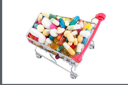Isolated shopping cart full of vitamin supplements on white backgrounds